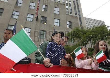 Kids on float with Italian flags