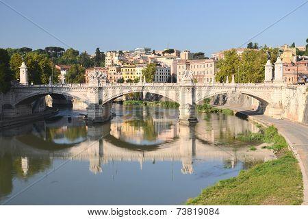 Picturesque view of Vittorio Emanuelle II Bridge over the Tiber river in Rome, Italy