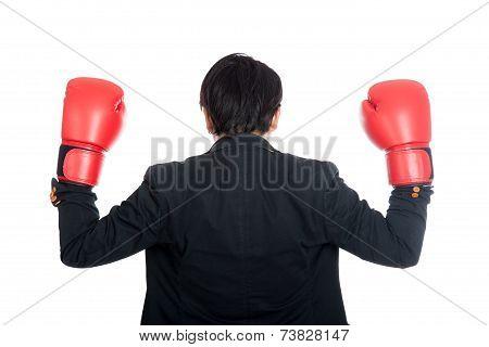 Back Of Asian Businessman Wear Boxing Gloves