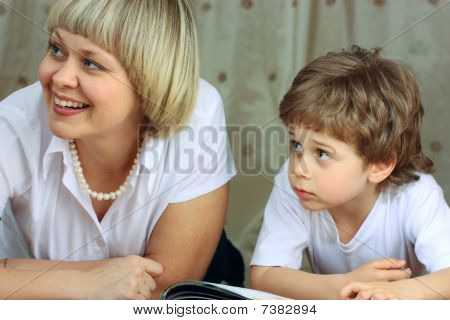 Woman And Little Boy Reading Book