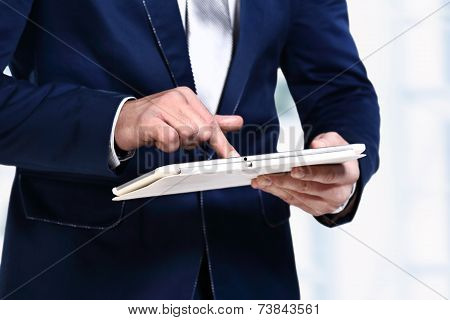 close up hands multitasking man using tablet laptop