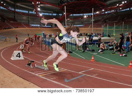 VIENNA, AUSTRIA - JANUARY 28, 2014: Lucia Slanikova (#243 Slovakia) places 3rd in the women's 400m event in an indoor track and field meeting.