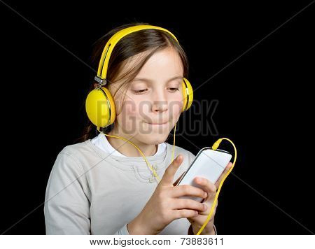 A Beautiful Young Girl Listening To Music With A Walkman