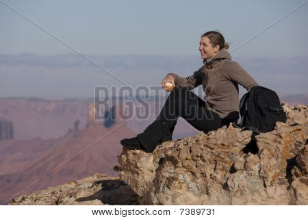 Attractive Female Hiker Sitting On A Rock