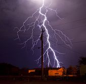 Extremely detailed lightning bolt behind electric utility pole poster