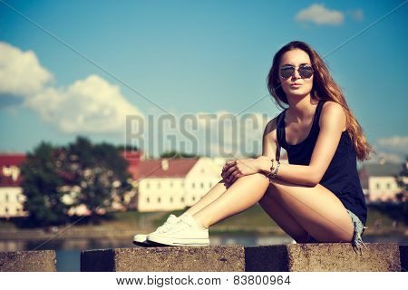 Trendy Hipster Girl Relaxing in the Park. Toned and Filtered Instagram Styled Photo. Modern Youth Lifestyle Concept. poster