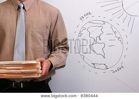 Man Holding A Stack Of Folders