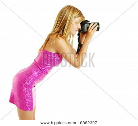 Side View Of A Blonde Photographing