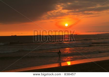 Sunset and surfer