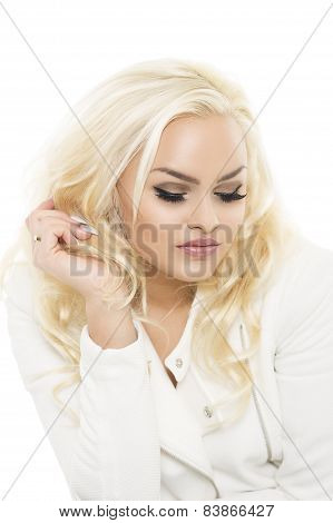 Sad Young Woman Sitting With Downcast Eyes