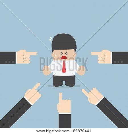 Businessman Being Pointed By A Lot Of Hands