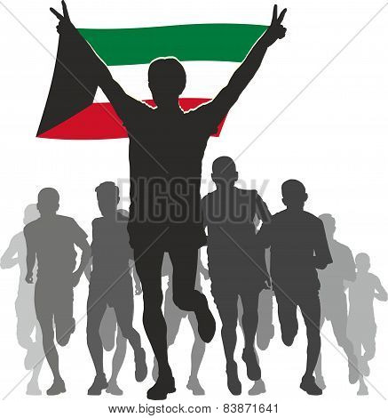 Athlete with the Kuwait flag at the finish