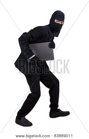 Businessman With Mask Stealing Laptop