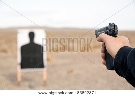 Target shooting with handgun on remote location poster