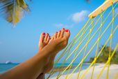 woman feet in hammock on the beach poster