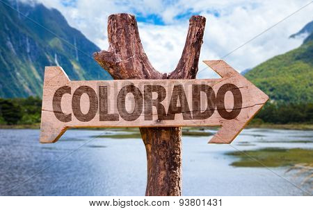 Colorado wooden sign with mountains background