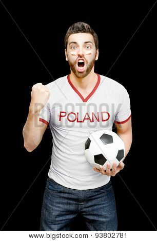 Polish fan holding a soccer ball celebrates on black background