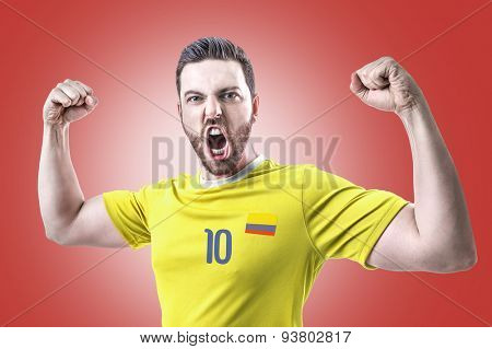Colombian soccer player celebrates on red background