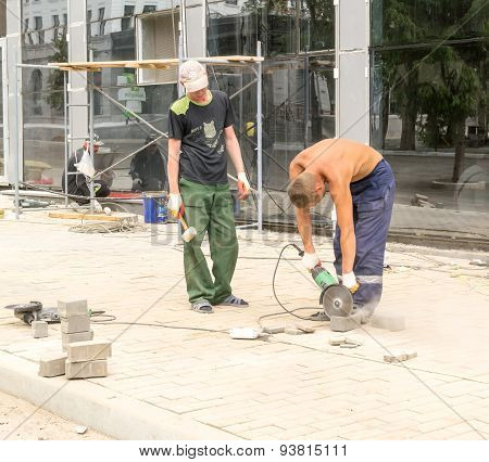 City Workers Cutting Brick Blocks