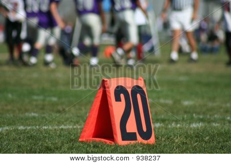 view of a football field at the 20 yard line. poster