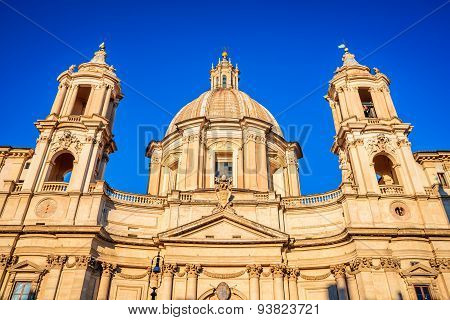 Rome Italy. Sunrise in Piazza Navona in Roma with the church of Sant'Agnese in Agone and the Obelisk of the Fontana dei Quattro Fiumi (the Fountain of the 4 Rivers) by Bernini