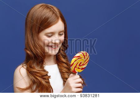 Pretty girl holding lollipop