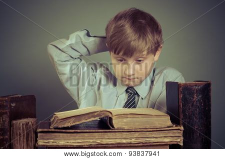 The boy spends time reading old books, Prodigy