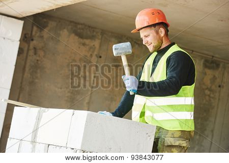 Bricklaying work. construction worker mason bricklayer installing calcium silicate brick  poster