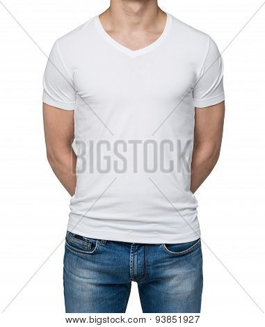Close Up Of The Body View Of The Man In A White T-shirt. Hands Are Crossed Behind The Back. Isolated
