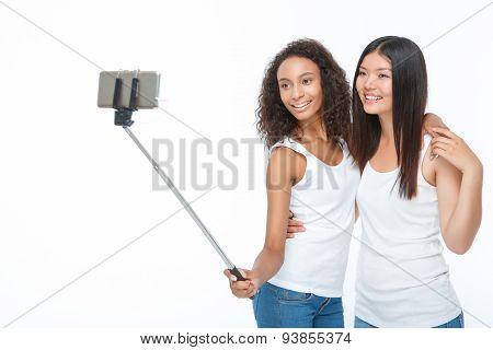 Smiling friends making selfie