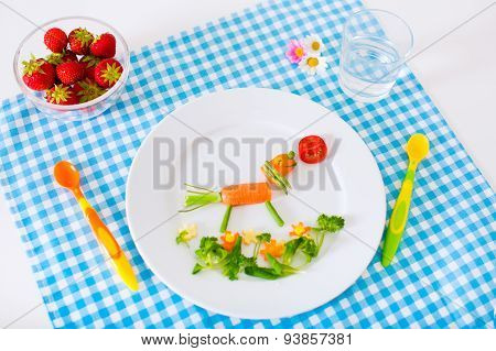 Healthy vegetarian lunch for little kids. Kid meal. Vegetable and fruit served as animals corn broccoli carrot strawberry helping child to learn eating right and clean children hands with spoon poster