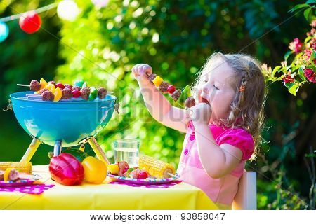 Little Girl At Garden Grill Party