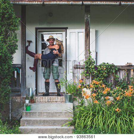 New house, happy  couple on doorstep
