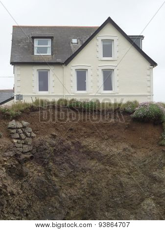 House On The Edge Of A Cliff Seascape