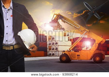 Manager Man Working In Container Dock Use For Transportation And Container Cargo Frieght And Logisti