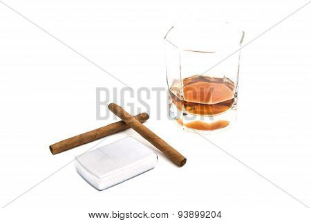 Cognac, Lighter And Two Cigarillos