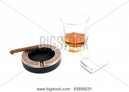 Cigarillo In Ashtray, Cognac And Lighter