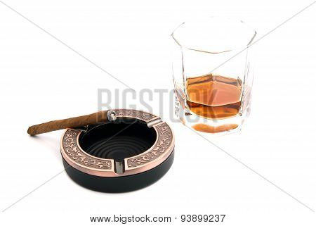 Cigarillo In Metal Ashtray And Cognac