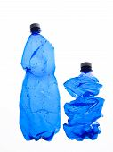 two crushed plastic blue bottles  on white background poster