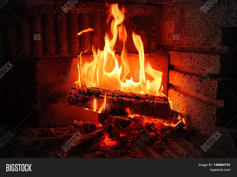 Burning Fireplace. Burning Wood In Brick Fireplace. Fireplace With A  Blazing Fire. Fire