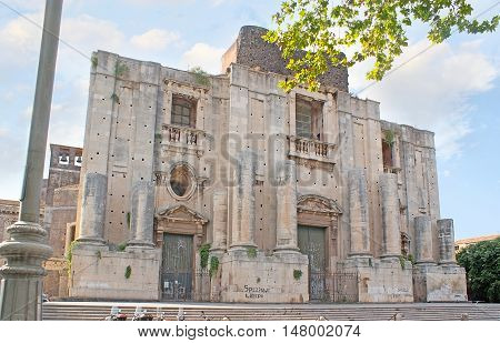 The uncompleted facade of St Nicholas Arena Church located adjacent to Benedictine Monastery in Dante Square Catania Sicily Italy.