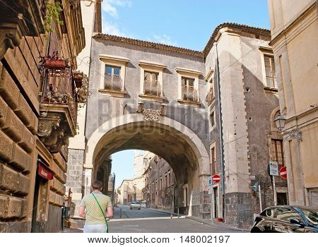 CATANIA ITALY - OCTOBER 10 2012: The historic Monastery Arch connecting St Benedict and St Magdalene Monasteries located in Teatro Grecco street on October 10 in Catania.