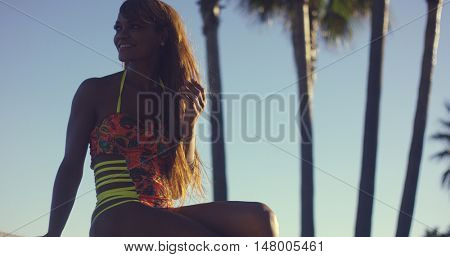 Sexy Woman Wearing Swimsuit Sitting on Bench