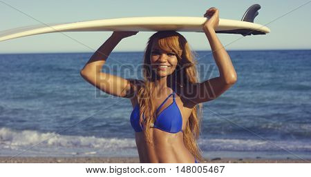 Sexy African Woman Holding Surfing Board Overhead