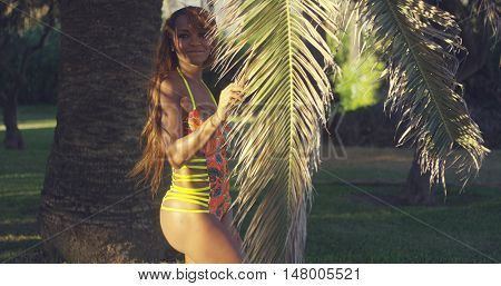 Sexy African Woman Standing at the Palm Tree