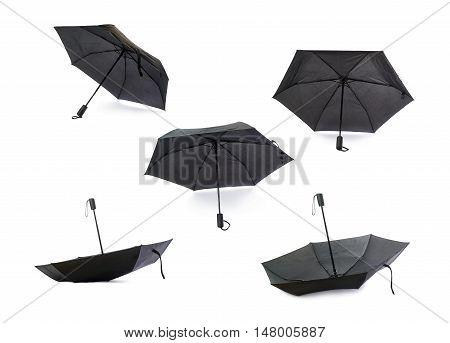 Set of Black unfolded umbrella isolated over the white background