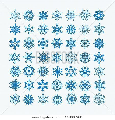 Collection of blue snowflakes on a white background vector illustration