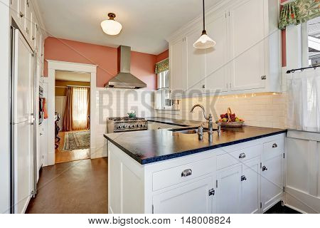 Classic Kitchen Room With White Cabinets, Granite Counter Top And Hardwood Floor.