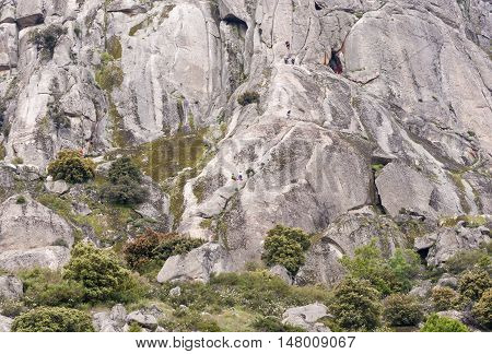 Climbers at Pico de la Miel (Honey Peak), in Sierra de la Cabrera, Guadarrama Mountains, Madrid, Spain