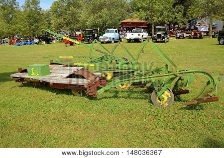ROLLAG, MINNESOTA, September 1, 2016: A vintage John Deere platform plow pulled by a steam engine is displayed at the West Central Steam Threshers Reunion in Rollag, MN attended by 1000's held annually on Labor Day weekend.